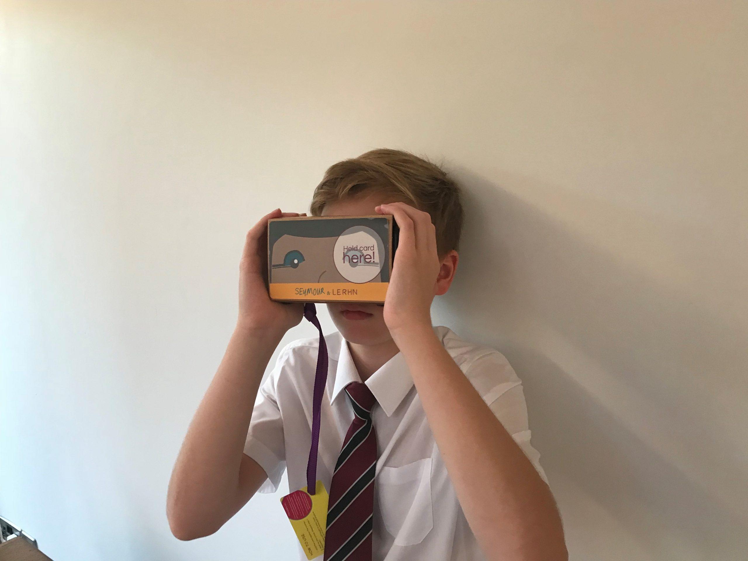 school pupil using virtual reality headset