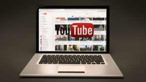 YouTube logo on laptop