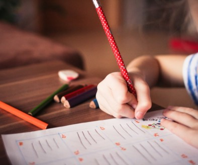 A child drawing with crayons