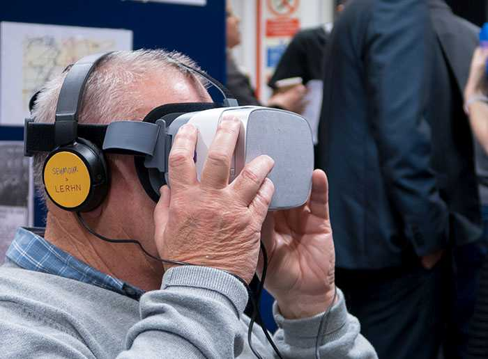 Elderly man using VR headset with Seymour & Lerhn headphones